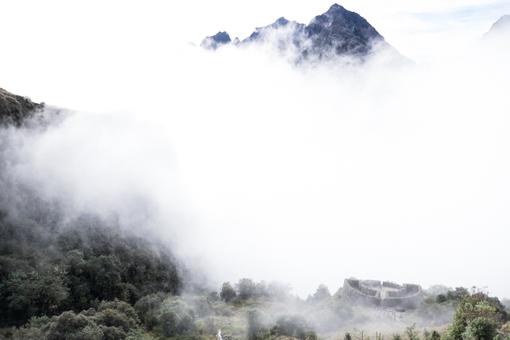 The mountain fog rolled in and out like a tide.  It would disappear as quickly as it arrived.
